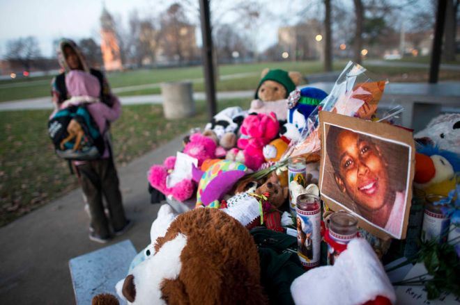 Kiara Jacobs, 8, hugs her brother Quentin Stamen, 13, at a memorial where Tamir Rice was fatally shot by Cleveland police officers who mistook the 12 year old's toy gun for a real gun.